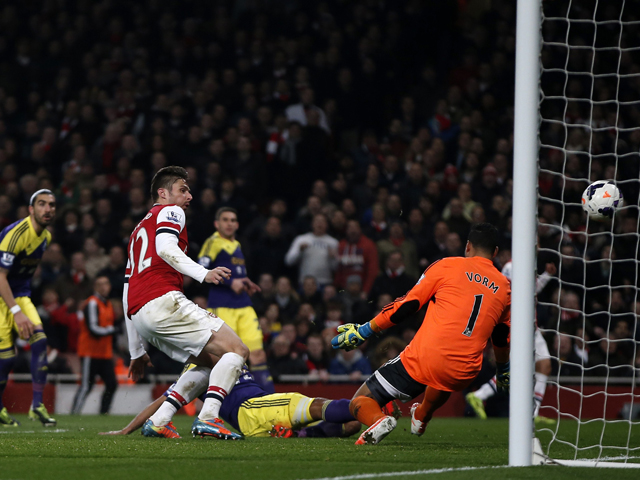 Arsenal's French striker Olivier Giroud shoots to score their second goal past Swansea City's Dutch goalkeeper Michel Vorm during the English Premier League football match between Arsenal and Swansea City at the Emirates Stadium in London on March 25, 201
