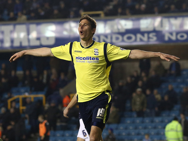 Nicola Zigic of Birmingham celebrates after scoring their third goal of the game during the Sky Bet Championship match between Millwall and Birmingham City at The Den on March 25, 2014