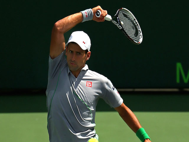 Novak Djokovic of Serbia returns a shot to Rafael Nadal of Spainduring the Final of the Sony Open at Crandon Park Tennis Center on March 30, 2014