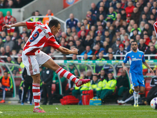 Peter Odemwingie of Stoke City scores during the Barclays Premier League match between Stoke City and Hull City at Britannia Stadium on March 29, 2014