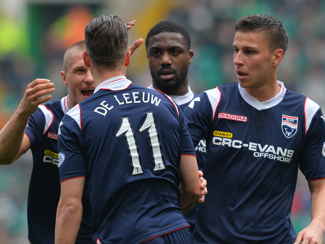 Melvin De Leeuw of Ross County celebrates his goal with his team mates during the Scottish Premier League match between Celtic and Ross County at Celtic Park Stadium on March 29, 2014
