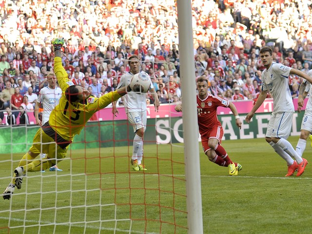 Bayern Munich's Swiss midfielder Xherdan Shaqiri (C) scores the second goal for his team during the German first division Bundesliga football match  on March 29, 2014