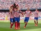 Raul Garcia of Atletico de Madrid celebrates scoring their opening goal with teammates during the La Liga match between Club Atletico de Madrid and Villarreal CF at Vicente Calderon Stadium on April 5, 2014