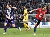 Lille's French forward Nolan Roux celebrates after scoring a goal during the French L1 football match Toulouse vs Lille on April 05, 2014