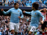 Carlos Tevez of Manchester City celebrates scoring his team's second goal, from a penalty, with team mate David Silva (R) during the Barclays Premier League match between Manchester City and Sunderland at the City of Manchester Stadium on April 3, 2011