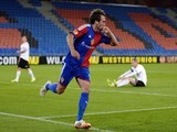 FC Basel's Argentinian midfielder Matias Emilio Delgado reacts after scoring the team's A goal during the UEFA  2014,Europa League quarter-final first leg football match against Valencia on April 3, 2014