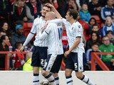 Scott Malone of Millwall celebrates scoring their first goal during the Sky Bet Championship match between Nottingham Forest and Millwall at City Ground on April 05, 2014