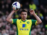 Russell Martin of Norwich City takes a throw during the Barclays Premier League match between Norwich City and Sunderland at Carrow Road on March 22, 2014