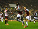 Mohamed Diame of West Ham celebrates with teammate Mark Noble after scoring his team's second goal during the Barclays Premier League match between Sunderland and West Ham United at the Stadium of Light on March 31, 2014