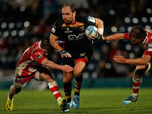 Andy Goode of London Wasps is tackled by Henry Trinder (L) and Billy Twelvetrees (R) of Gloucester during the Amlin Challenge Cup Quarter Final match on April 6, 2014