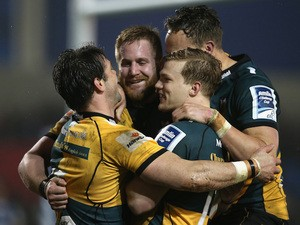 Ben Foden (L) of Northampton celebrates with team mates after scoring a try during the Amlin Challenge Cup quarter final match against Sale Sharks on April 3, 2014
