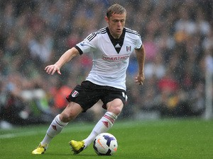 Damien Duff of Fulham with the ball during of the Barclays Premier League match between Fulham and Arsenal at Craven Cottage on August 24, 2013