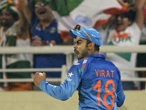 ndia cricketer Virat Kohli reacts after successfully taking a catch to dismiss Sri Lanka batsman Tillakaratne Dilshan during the ICC World Twenty20 cricket tournament final match between India and Sri Lanka in The Sher-e-Bangla National Cricket Stadium in