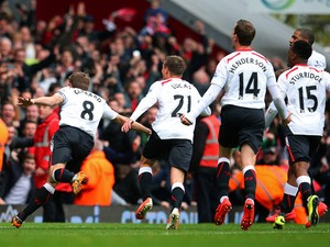 Steven Gerrard #8 of Liverpool celebrates after scoring his team's second goal from the penalty spot during the Barclays Premier League match between West Ham United and Liverpool at Boleyn Ground on April 6, 2014