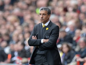 Chris Hughton, Manager of Norwich City on the touchline during the Barclays Premier League match between Swansea City and Norwich City at Liberty Stadium on March 29, 2014