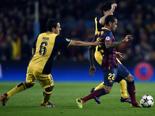 Barcelona's Brazilian defender Dani Alves (R) vies with Atletico Madrid's midfielder Koke (L) during the UEFA Champions League quarterfinal first leg football match on April 1, 2014