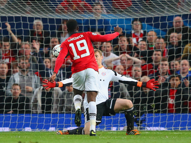Danny Welbeck of Manchester United attempts to chip the goalkeeper Manuel Neuer of Bayern Muenchen during the UEFA Champions League Quarter Final first leg match on April 1, 2014