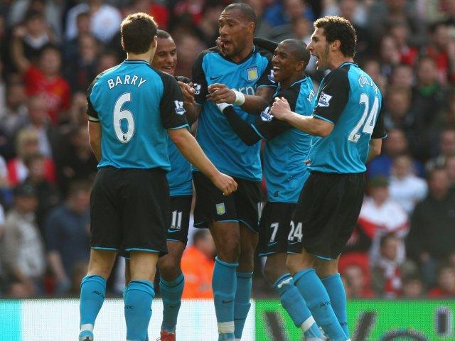 Aston Villa players celebrate John Carew's goal against Manchester United on April 05, 2009.
