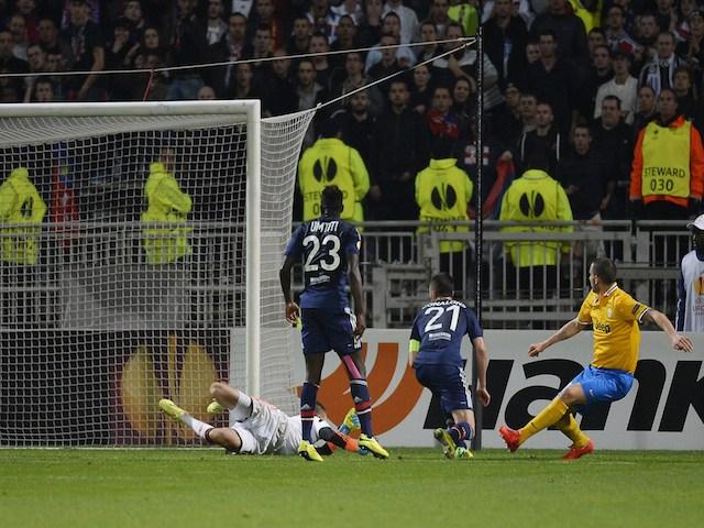 Juventus' Italian defender Leonardo Bonucci (R) scores during the UEFA Europa League (C3) quarter final football match Olympique Lyonnais (OL) vs Juventus Turin, on April 3, 2014