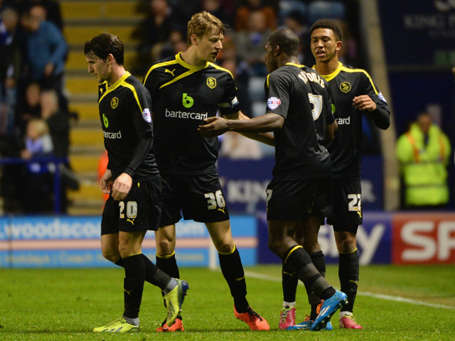 Glenn Loovens and Liam Palmer of Sheffield Wednesday congratulate Michail Antonio of Sheffield Wednesday on scoring their first goal during the Sky Bet Championship match between Leicester City and Sheffield Wednesday at The King Power Stadium on April 04
