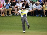 Bubba Watson of the US reacts after making a birdie putt on the 14th green during the second round of the 78th Masters Golf Tournament at Augusta National Golf Club on April 11, 2014