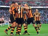 Hull's Matty Fryatt celebrates with team mates after scoring his team's second goal against Sheffield United during the FA Cup semi final match on April 13, 2014