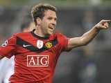 Michael Owen celebrates scoring for Manchester United against Wolfsburg on December 08, 2009.