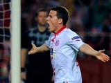 Sevilla's French forward Kevin Gameiro celebrates after scoring during the UEFA Europa League quarterfinal second leg football match Sevilla FC vs FC Porto at the Ramon Sanchez Pizjuan stadium in Sevilla on April 10, 2014