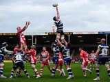 Stuart Hooper of Bath (C) stretches for the line out during the Aviva Premiership match between Gloucester and Bath at Kingsholm Stadium on April 12, 2014