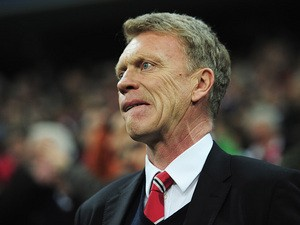 Manchester United manager David Moyes look on against Bayern Munich in the Champions League quarter final match on April 9, 2014