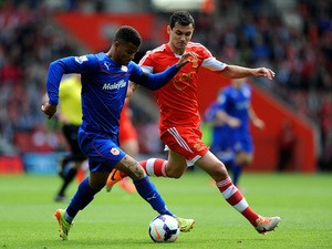 Fraizer Campbell of Cardiff is pursued by Dejan Lovren of Southampton during the Barclays Premier League match on April 12, 2014