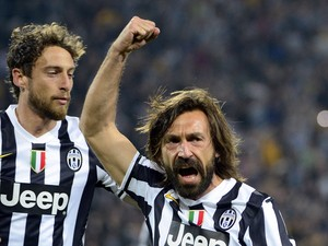 Juventus' midfielder Andrea Pirlo celebrates after scoring during the UEFA Europa League quarter-final football match Juventus vs Olympique Lyonnais, on April 10, 2014