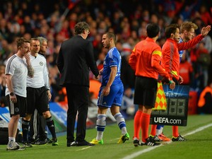 Head Coach Laurent Blanc of PSG shakes hands with Eden Hazard of Chelsea as he is replaced by Andre Schurrle of Chelsea during the UEFA Champions League Quarter Final second leg match between Chelsea and Paris Saint-Germain FC at Stamford Bridge on April