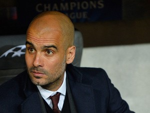 Bayern Munich head coach Pep Guardiola looks on prior to kick-off in the Champions League quarter final match against Manchester United on April 9, 2014