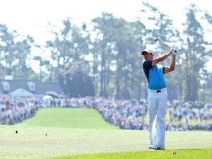 Rory McIlroy of Northern Ireland watches his approach shot on the first hole during the third round of the 2014 Masters Tournament at Augusta National Golf Club on April 12, 2014