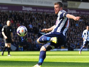 West Bromwich Albion's Irish midfielder Chris Brunt scores the second goal during the English Premier League football match between West Bromwich Albion and Tottenham Hotspur at The Hawthorns in West Bromwich on April 12, 2014