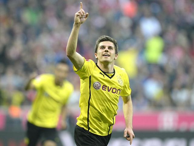 Dortmund's Jonas Hofmann celebrates after scoring his team's third goal against Bayern Munich during the Bundesliga match on April 12, 2014