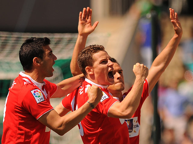 Sevilla's Kevin Gameiro celebrates after scoring the opening goal against Real Betis during the La Liga match on April 13, 2014
