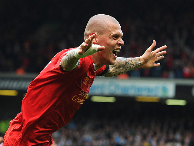 Liverpool's Martin Skrtel celebrates after scoring his team's second goal against Manchester City during the Premier League match on April 13, 2014