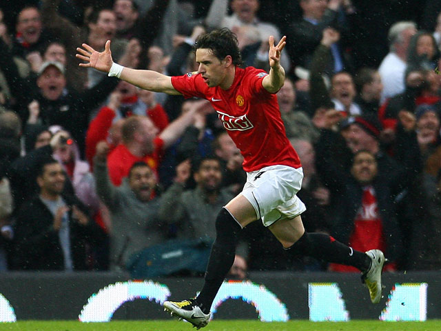 Manchester United's Owen Hargreaves celebrates after scoring his team's second goal against Arsenal during the Premier League match on April 13, 2008