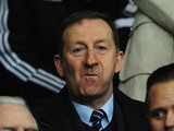 Swansea chairman Huw Jenkins (c) looks on before the UEFA Europa League Round of 32 first leg between Swansea City and SSC Napoli at Liberty Stadium on February 20, 2014