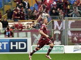 Torino's Jasmin Kurtic celebrates after scoring his team's first goal against Lazio during the Serie A match on April 19, 2014