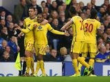 Crystal Palace's Jason Puncheon celebrates with team mates after scoring the opening goal against Everton during the Premier League match on April 16, 2014