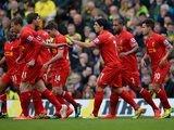 Liverpool's Luis Suarez celebrates with teammates after scoring his team's second goal against Norwich during the Premier League match on April 20, 2014