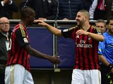 AC Milan's Adel Taarabt celebrates with teammate Mario Balotelli after scoring his team's second goal against Livorno during the Serie A match on April 19, 2014