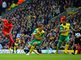 Liverpool's Raheem Sterling fires in the first goal against Norwich City at Carrow Road in the Premier League on April 20, 2014