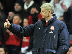 Arsenal's French manager Arsene Wenger gestures during the English Premier League football match between Arsenal and West Ham United at the Emirates Stadium in London on April 15, 2014