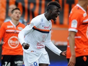 Montpellier's French forward Mbaye Niang celebrates after scoring a goal during the French L1 football match between Lorient and Montpellier on April 20, 2014