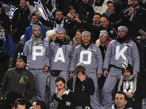 PAOK FC fans show their support during the UEFA Europa League Round of 32 first leg match between Udinese Calcio and PAOK FC at Friuli Stadium on February 16, 2012