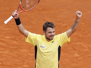 Stanislas Wawrinka celebrates after beating David Ferrer during the Monte Carlo Masters match on April 19, 2014